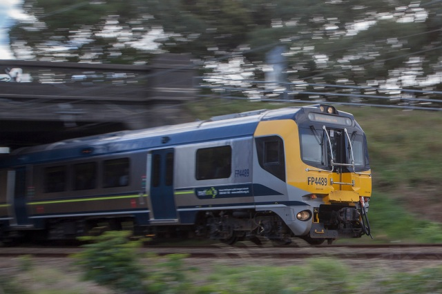 A North bound Wellington commuter train at speed approaching Woburn station