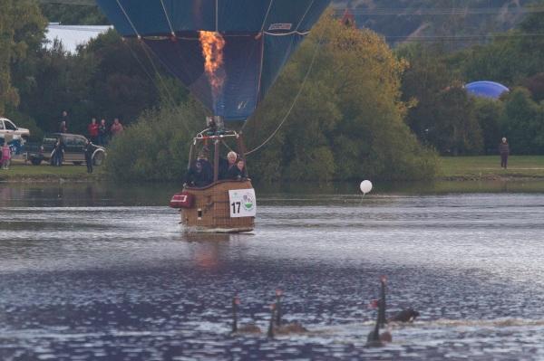 Hot air balloon basket skimming Lake Henley