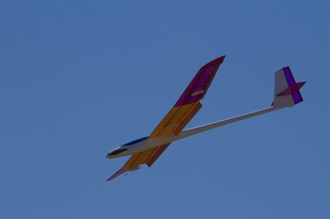 Model glider descending rapidly with full brakes