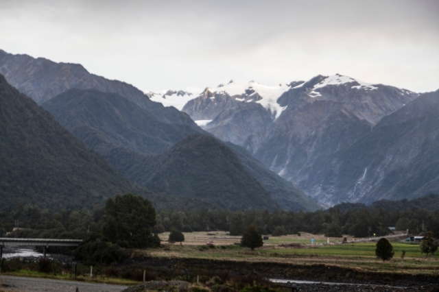The Franz Josef Glacier is up there in  those clouded peaks
