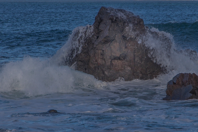 Sturdy rock withstands the waves