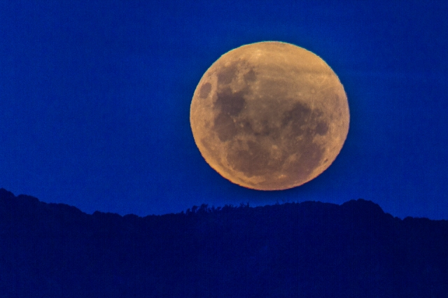 Supermoon arising over the Eastern hills