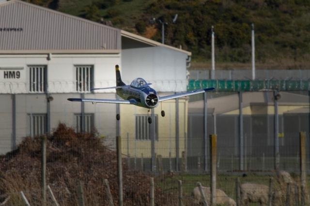 Model aircraft landing near the prison