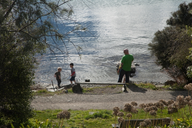 Kids throwing rocks into the lake ... under supervision