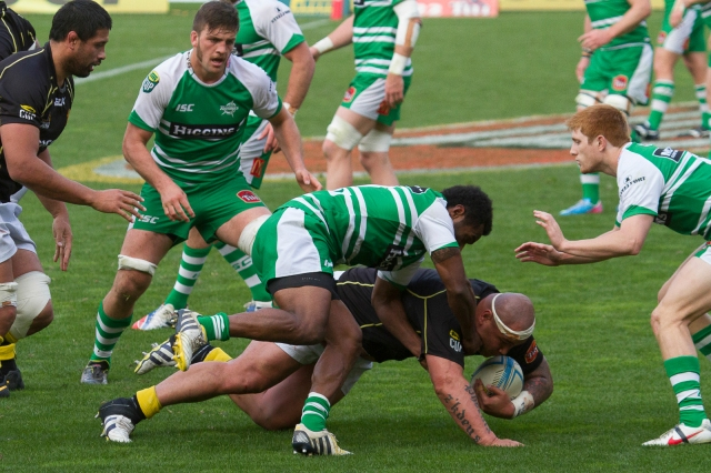 A Wellington player goes to ground in the midst of heavy pressure from Manawatu