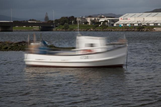 """The work boat, """"J.Vee"""" swings at her moorings"""