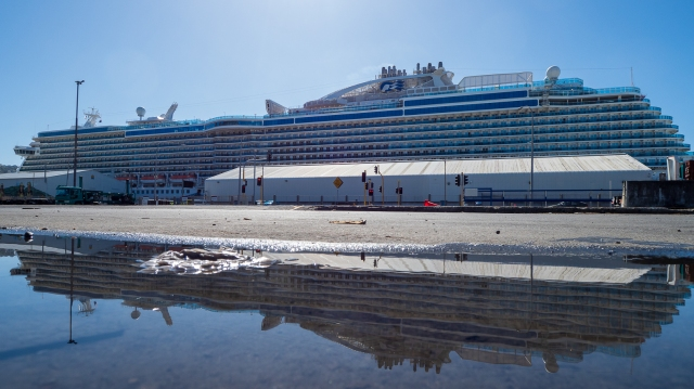 The cruise-liner Majestic Princess reflected in a puddle
